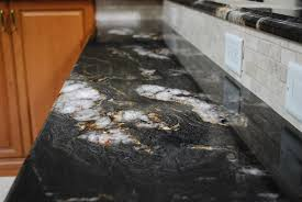 image result for titanium granite countertops with white cabinets