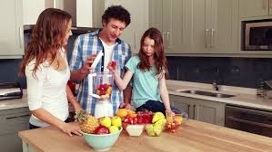happy family making smoothie in the kitchen stock footage video