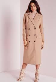 nikki reed looks super chic in camel coat alongside ian