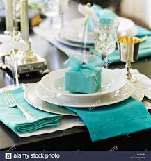 Formal Table Setting Formal Table Setting With White Dishes And Blue Gift And Stock