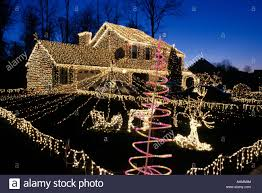 christmas house lights entire house and yard decorated with christmas lights stock photo