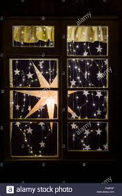 festive christmas house window display christmas star and lights