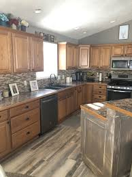 should you paint or stain oak cabinets should i paint my oak cabinets or keep them stained