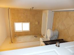 bathtub with shower surround window in shower what would you do