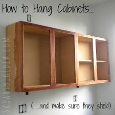 how to install wall cabinets how to hang cabinets sarah s big idea