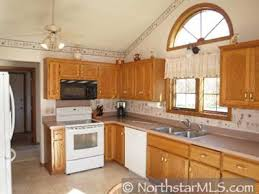 what color countertops look with brown cabinets wall paint color to make mauve countertops look less