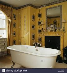 Yellow Fireplace by Print Room Wallpaper In Yellow Bathroom With Roll Top Bath In
