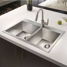 modern kitchen with sleek countertops and steel double bowl sinks