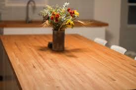 diy butcher block countertops made from leftover flooring work this is a project for someone who wants high end countertops on the cheap and has a lot of time to make them