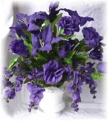 silver blumebox with green white u0026 purple flower arrangements