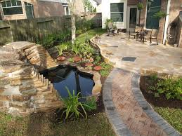 appealing brick wall and lovely small pool plus sitting area in