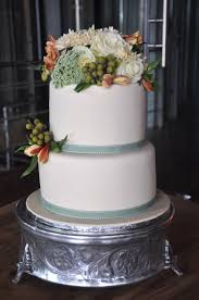 plain wedding cakes rozanne s cakes plain ivory color wedding cake with fresh flowers