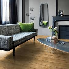 flooring quick step laminate and gray sofa plus oval coffee table