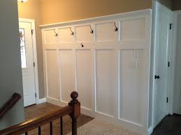 Entryway Wainscoting With Hooks For Coats And A Shelf For - Bedroom wainscoting ideas