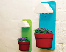 self watering plants this rainy pot self watering planter is impossibly cute