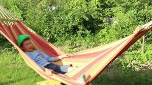 boy reading in hammock stock footage video 1232518 shutterstock