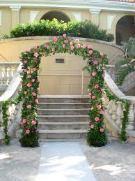 garden wedding arch covered with ivy and pink roses shades of