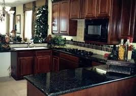 Cherry Wood Kitchen Cabinets With Black Granite Granite Cabinets 043 Granite Verde Butterfly Kitchen