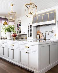 29 of the chicest marble kitchens on instagram brit co art deco inspired modern gold and marble finishes amplify the art deco inspired aspect of this otherwise classic kitchen and the built in bookshelf and