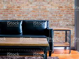 moderm living room interior design with couch brick wall