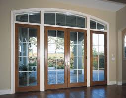 white and wood colors frame these french doors with large grids