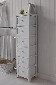 a crisp white freestanding bathroom storage furniture a narrow
