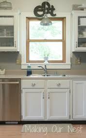 white kitchen cabinets with window trim kitchen window ledge our nest kitchen cabinet