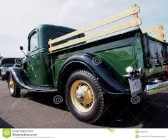 Old Ford Truck Vector - restored green and black antique ford delivery truck editorial
