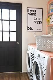 20 swoon worthy laundry rooms yep laundry rooms brit co 15 be creative because there isn t a lot of counter space to spare take advantage of your wall space to add decorative touches like bright paint or cute