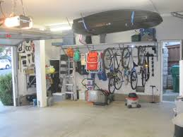 garage organization bike hooks shelves combined with overhead box