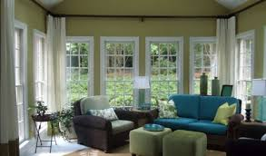 interior sunroom design idea with wide glass doors and windows