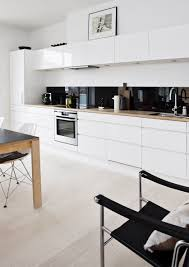 Black White Kitchen Ideas by White Kitchen Cabinets With Timber Bench Black Colour Back Splash