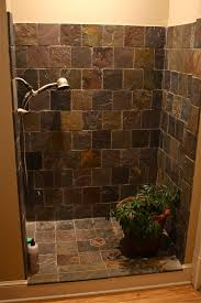 bathroom stone walk in shower and stainless shower plus indoor