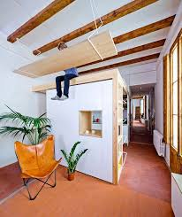 space savvy kitchen and mezzanine in small barcelona apartment