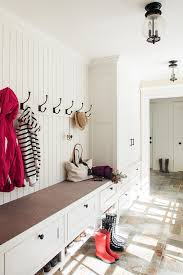 built in mudroom bench under row of hooks transitional laundry