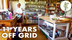 style house 11 years living grid in an earthship style house