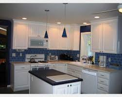 interior blue glass tile backsplash and stainless also blue