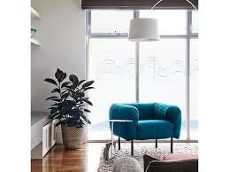 club chairs beige armchair wall archway white window trim throw