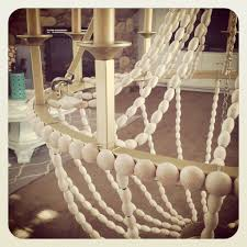 Beachy Chandeliers by Upcycle A Plain Chandelier Into A Beaded Showpiece