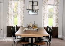 kitchen dining table with classic black iron hanging chandelier