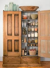 cheap tv armoire to convert this armoire into a kitchen pantry the homeowner added