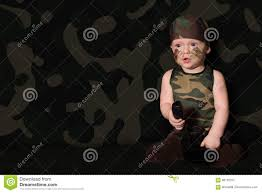 halloween face paint kids black background baby soldier in uniform with war paint on his face boy in unifo