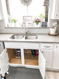 how to raise cabinets the floor how to protect your kitchen cabinets from water damage