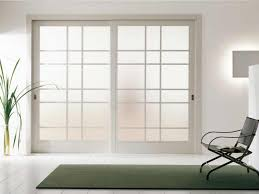 sliding frosted glass partition door with white steel frame on