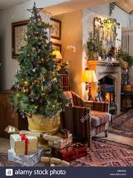 christmas tree in sitting room with kilim style upholstered