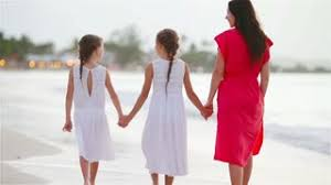 young little girls src adorable little girls and young mother walking on white beach in the