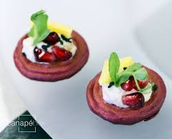 bellini canape baba ganoush on beetroot blini pomegranate golden beetroot black
