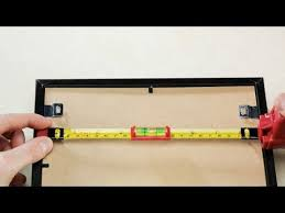 how to hang a picture frame how to hang a picture frame perfectly straight the first time