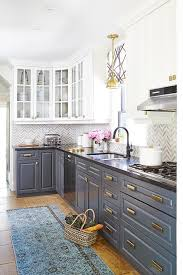 kitchen cabinets gray bottom white top white cabinets and gray lower cabinets with brass