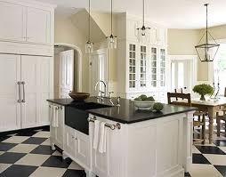 white shaker kitchen cabinets with black countertops kitchen